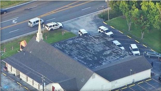 Police converged on a church in Baytown, Texas, where a pastor shot an alleged burglar on Tuesday, July 28, 2015.   / CBS  KHOU
